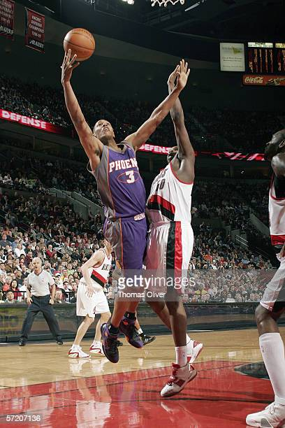 Boris Diaw of the Phoenix Suns goes to the basket against Zach Randolph of the Portland Trail Blazers during the game at the Rose Garden on March 12...