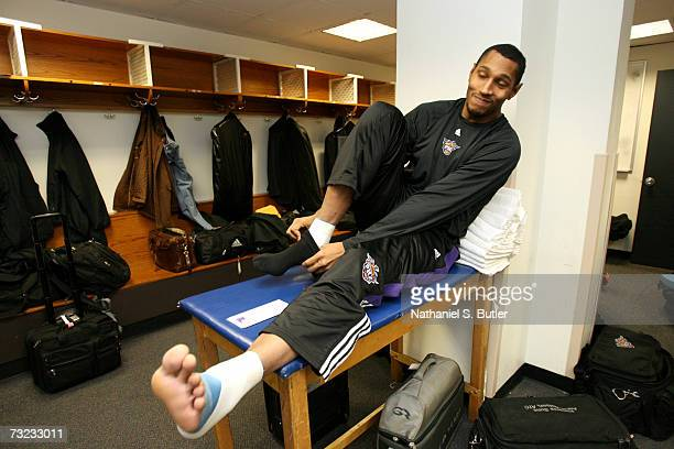 Boris Diaw of the Phoenix Suns pulls a sock over his foot before the game against the New York Knicks on January 24 2007 at Madison Square Garden in...