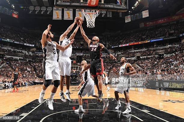 Boris Diaw of the San Antonio Spurs attempts a rebound while being contested by Ray Allen of the Miami Heat during Game Five of the 2014 NBA Finals...