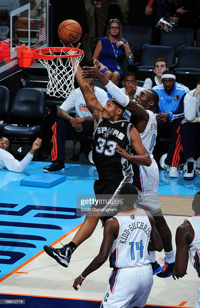 Boris Diaw #33 of the San Antonio Spurs drives to the basket against the Charlotte Bobcats at Time Warner Cable Arena on December 8, 2012 in Charlotte, North Carolina.