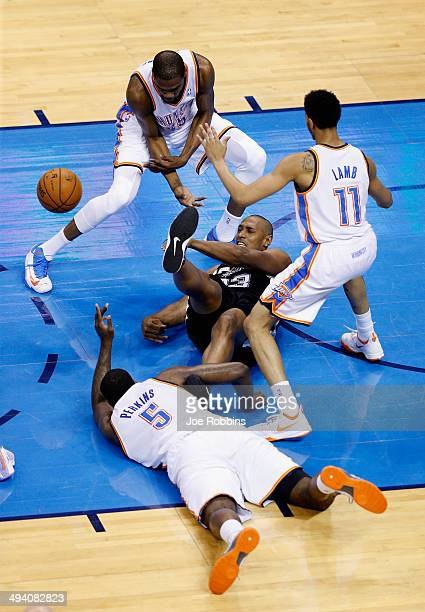 Boris Diaw of the San Antonio Spurs fights for a loose ball with Kendrick Perkins Kevin Durant and Jeremy Lamb of the Oklahoma City Thunder in the...