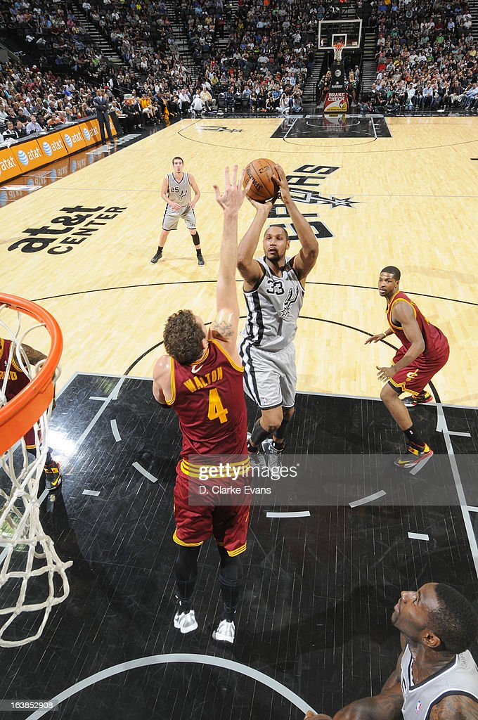 Boris Diaw #33 of the San Antonio Spurs goes to the basket against Luke Walton #4 of the Cleveland Cavaliers during the game between the Cleveland Cavaliers and the San Antonio Spurs on March 16, 2013 at the AT&T Center in San Antonio, Texas.