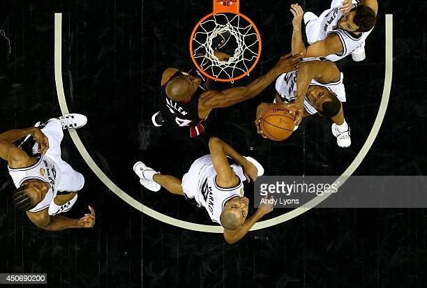 Boris Diaw of the San Antonio Spurs goes to the basket against Ray Allen of the Miami Heat during Game Five of the 2014 NBA Finals at the ATT Center...