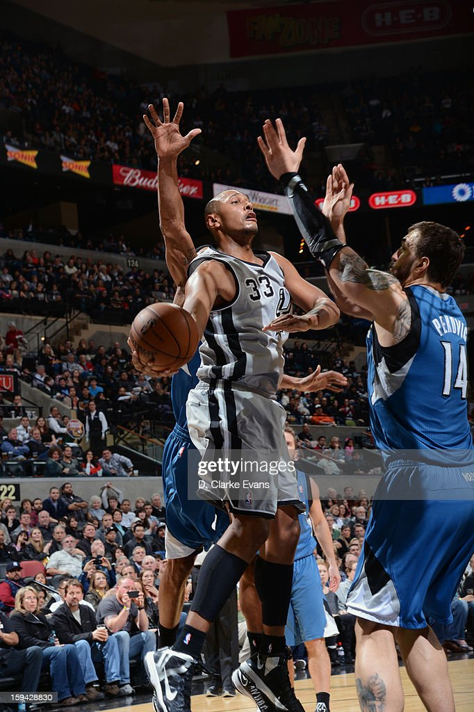 Boris Diaw #33 of the San Antonio Spurs makes a pass against Nikola Pekovic #14 of the Minnesota Timberwolves on January 13, 2013 at the AT&T Center in San Antonio, Texas.
