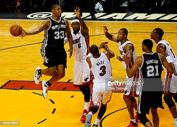 Boris Diaw of the San Antonio Spurs passes the ball as LeBron James of the Miami Heat defends during Game Four of the 2014 NBA Finals at American...