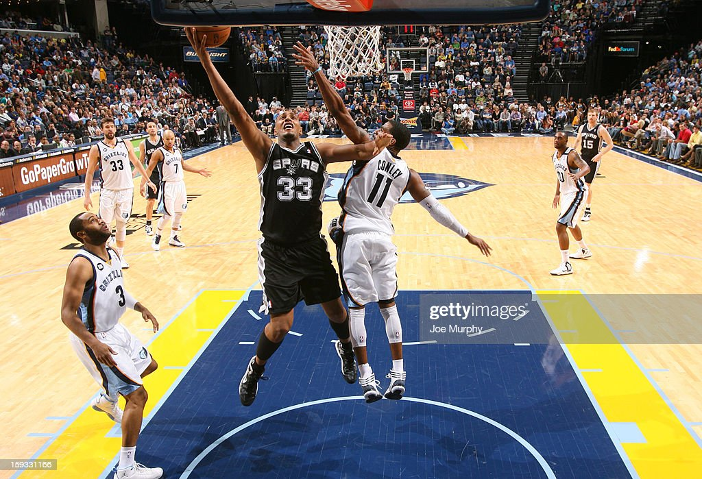 Boris Diaw #33 of the San Antonio Spurs shoots a layup against Mike Conley #11 of the Memphis Grizzlies on January 11, 2013 at FedExForum in Memphis, Tennessee.