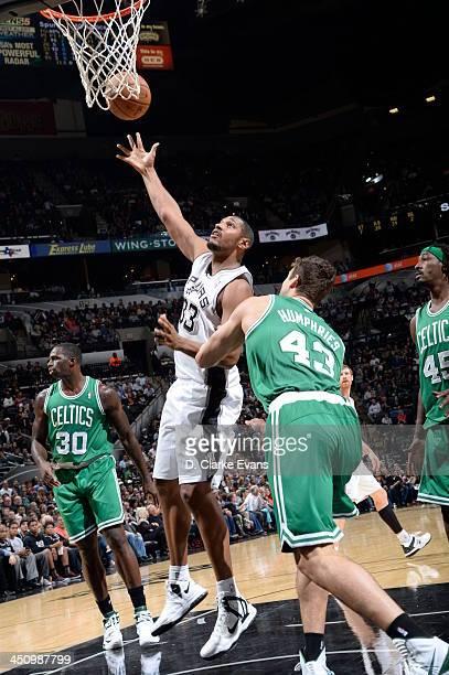 Boris Diaw of the San Antonio Spurs shoots against Kris Humphries of the Boston Celtics at the ATT Center on November 20 2013 in San Antonio Texas...