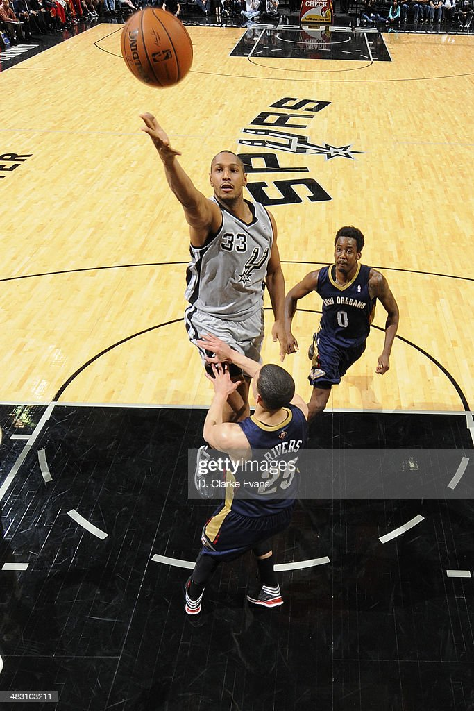 Boris Diaw #33 of the San Antonio Spurs takes a shot against the New Orleans Pelicans at the AT&T Center on March 29, 2014 in San Antonio, Texas.