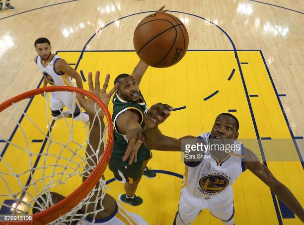 Boris Diaw of the Utah Jazz battles for a rebound against Kevin Durant of the Golden State Warriors during Game One of the NBA Western Conference...