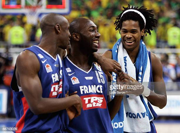 Boris Diaw, Sanya Giffa and Mickael Gelabale from France celebrate winning the FIBA EuroBasket 2005 quarter final match between France and Lithuania...