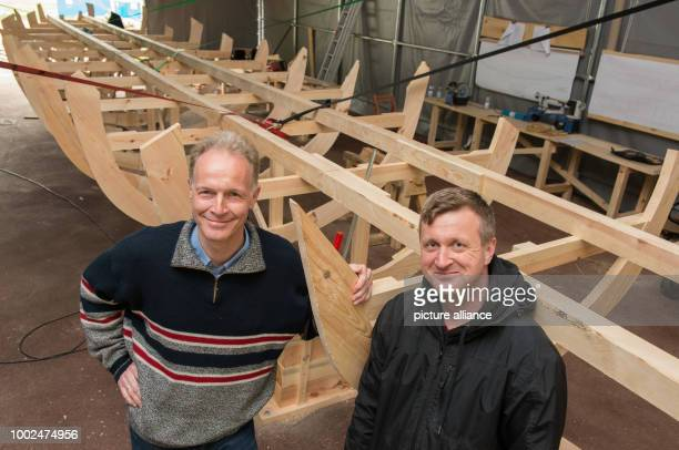 Boris Dreyer Professor for Ancient History at the Friedrich Alexander University ErlangenNuremberg and ship constructor Falk Andraschko pose in front...