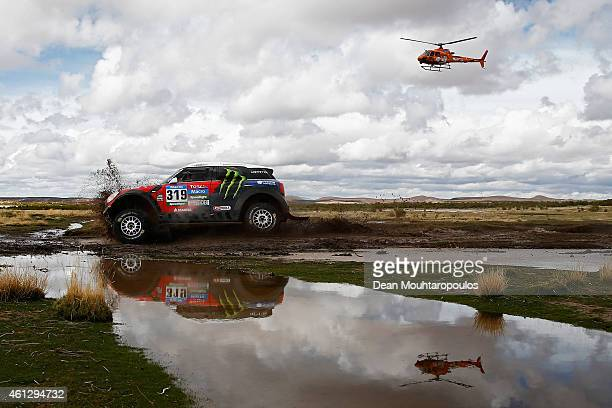 Boris Garafulic of Chile and Filipe Palmeiro of Portugal for XRaid Team ALL4 Racing mini are followed by the TV helicopter during day 7 of the Dakar...