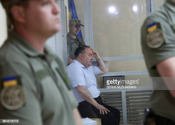 Boris German head of a UkrainianGerman weapons firm attends a court hearing in Kiev on May 31 2018 after being arrested the day before for being the...