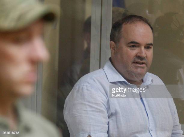 Boris German who suspected of organizing an attempt on killing of Russian journalist Arkady Babchenko sits in a cage during a court trial on a...