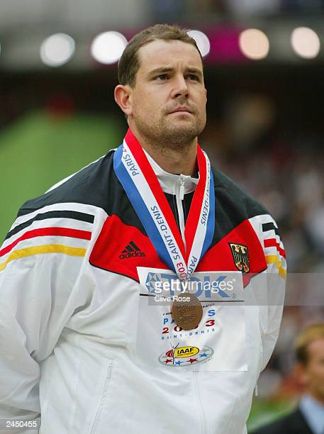 Boris Henry of Germany poses with his bronze medal after finishing third in the men's javelin throw at the 9th IAAF World Athletics Championship at...