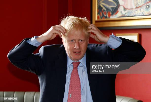 Boris Johnson a leadership candidate for Britain's Conservative Party visits Wetherspoons Metropolitan Bar to meet with JD Wetherspoon chairman Tim...