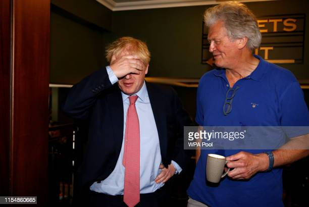 Boris Johnson a leadership candidate for Britain's Conservative Party meets with JD Wetherspoon chairman Tim Martin as he visits Wetherspoons...