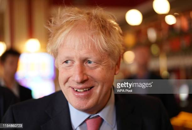 Boris Johnson a leadership candidate for Britain's Conservative Party meets with JD Wetherspoon chairman Tim Martin at Wetherspoons Metropolitan Bar...