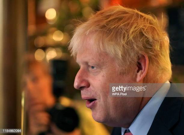 Boris Johnson a leadership candidate for Britain's Conservative Party visits Wetherspoons Metropolitan Bar to meet with with JD Wetherspoon chairman...