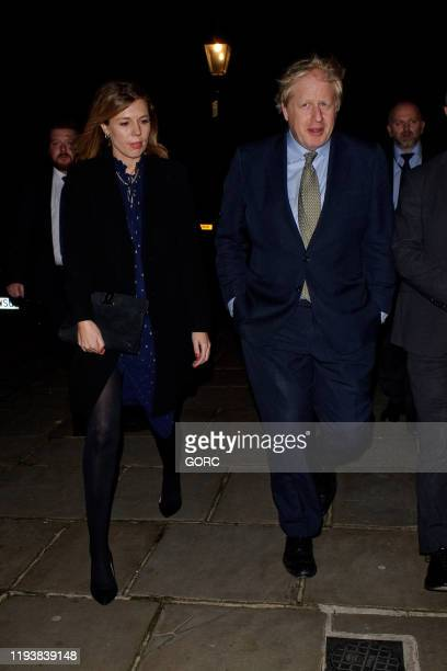 Boris Johnson and Carrie Symonds seen attending Evgeny Lebedev's Christmas Party at a private North London residence on December 13, 2019 in London,...
