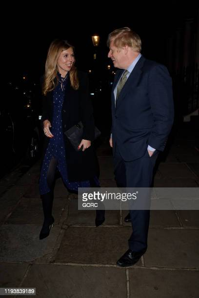 Boris Johnson and Carrie Symonds seen attending Evgeny Lebedev's Christmas Party at a private North London residence on December 13 2019 in London...