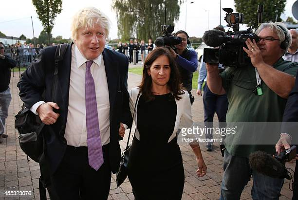 Boris Johnson and his wife Marina are surrounded by reporters as they arrive at Ruislip High School on September 12 2014 in Uxbridge England Mr...