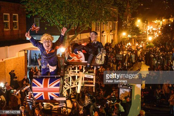 Boris Johnson and Jacob Rees-Mogg effigies are paraded through the streets during traditional Bonfire Night celebrations on November 5, 2019 in...
