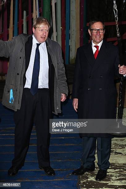 Boris Johnson and Richard Desmond attend a photocall at The Shadwell Community Project on January 14 2014 in London England