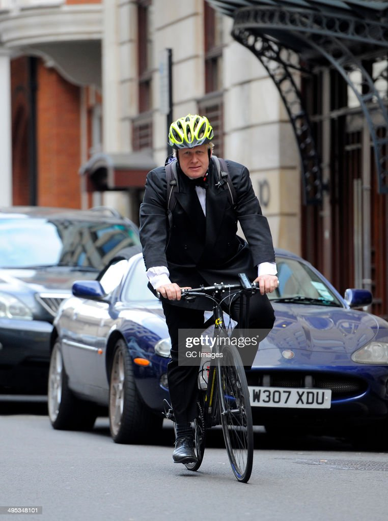 Boris Johnson arrives at The Mayfair Hotel on his bicycle on June 2, 2014 in London, England.