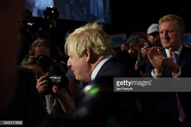 Boris Johnson arrives to deliver his leader's keynote speech during the Conservative Party conference at Manchester Central Convention Complex on...