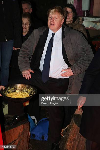 Boris Johnson attends a photocall at The Shadwell Community Project on January 14 2014 in London England