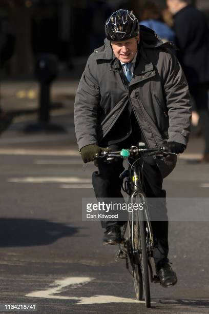 Boris Johnson cycles into Westminster on April 1 2019 in London England MPs in Parliament will vote on alternative arrangements for Brexit in a...