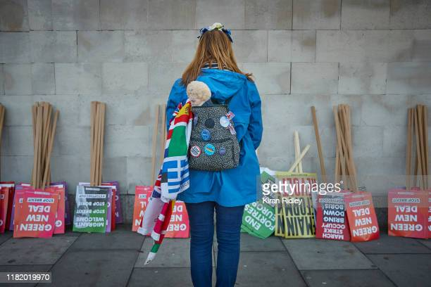 Boris Johnson doll pokes out from a protestors bag as crowds gather at Park Lane for the People's Vote Rally on October 19 2019 in London England...