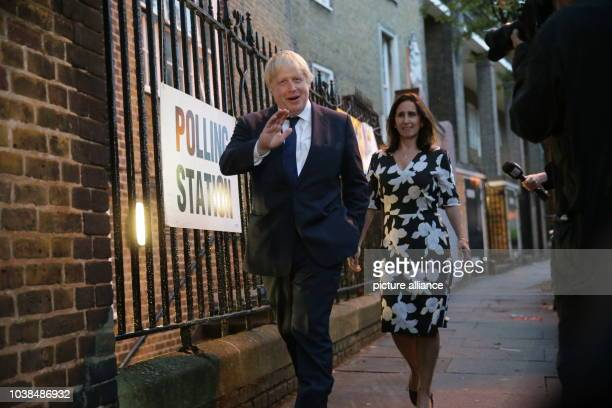Boris Johnson former London mayor and supporter of the Leave campaign and his wife Marina Wheeler head to a polling station to vote in the...