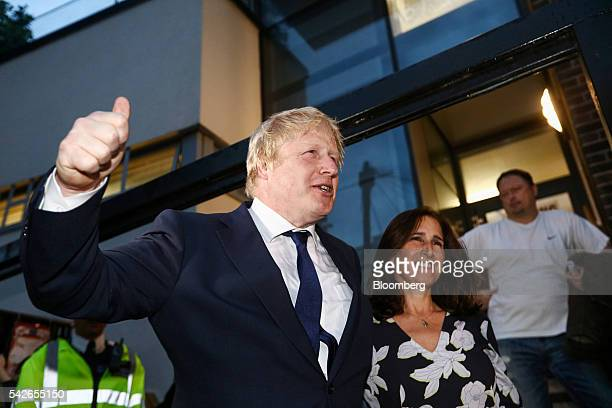 Boris Johnson former mayor of London center leaves with Marina Wheeler his wife after casting his vote in the European Union referendum at the...