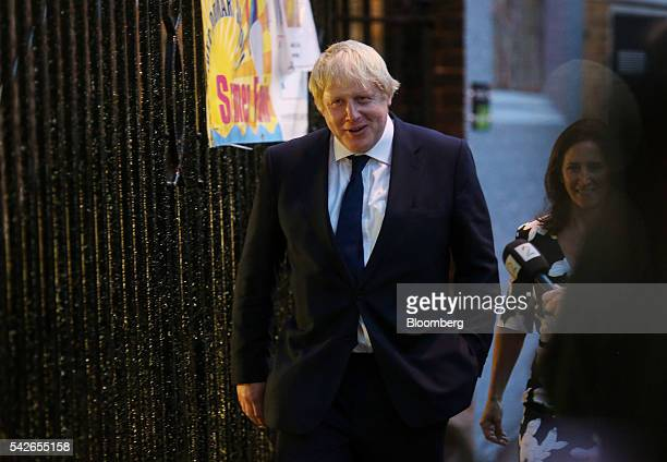 Boris Johnson former mayor of London left arrives with Marina Wheeler his wife to cast his vote in the European Union referendum at the Hanover...