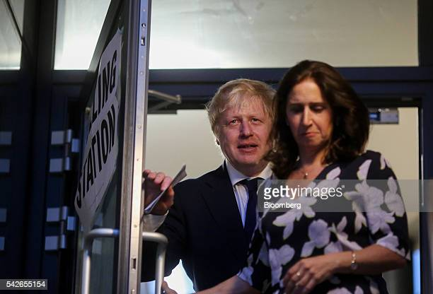 Boris Johnson former mayor of London left leaves with Marina Wheeler his wife after casting his vote in the European Union referendum at the Hanover...