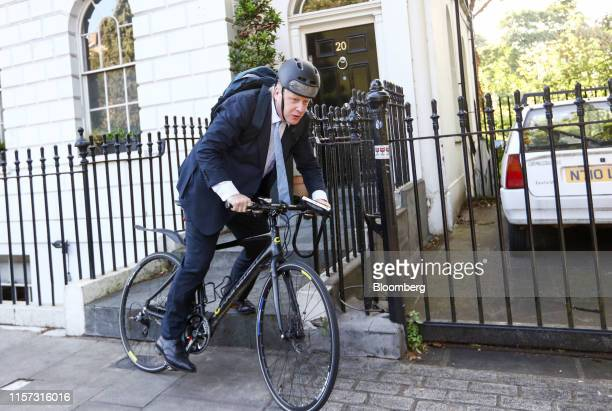 Boris Johnson former mayor of London rides a bicycle as he leaves his home in London UK on Tuesday June 21 2016 Around midday today in London Britain...