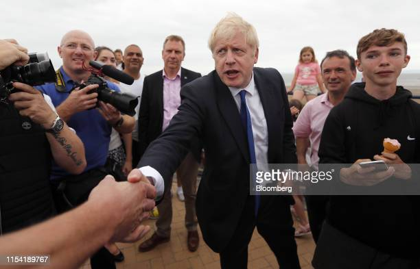 Boris Johnson former UK foreign secretary center greets attendees as part of his Conservative Party leadership campaign tour in Barry Island Wales UK...