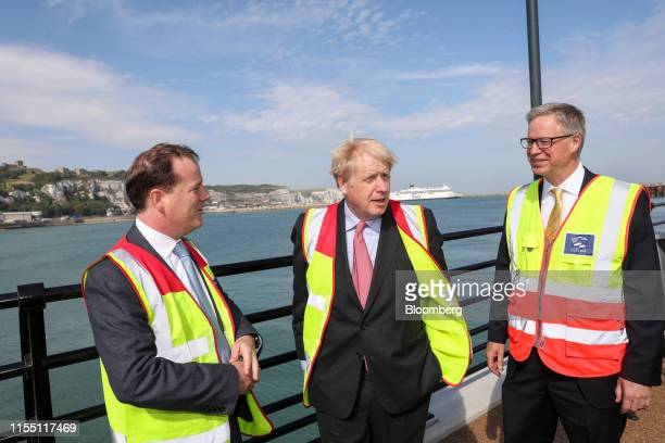 Boris Johnson former UK foreign secretary center speaks with Charlie Elphicke UK lawmaker left and Doug Bannister chief executive officer of Port of...