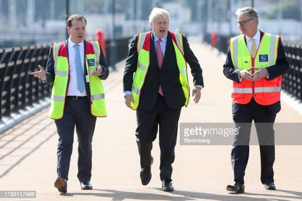 Boris Johnson former UK foreign secretary center walks with Charlie Elphicke UK lawmaker left and Doug Bannister chief executive officer of Port of...