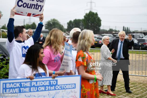 Boris Johnson greets Conservative MP Nadine Dorries and supporters before the Conservative leadership hustings on July 13 2019 in Wyboston England...