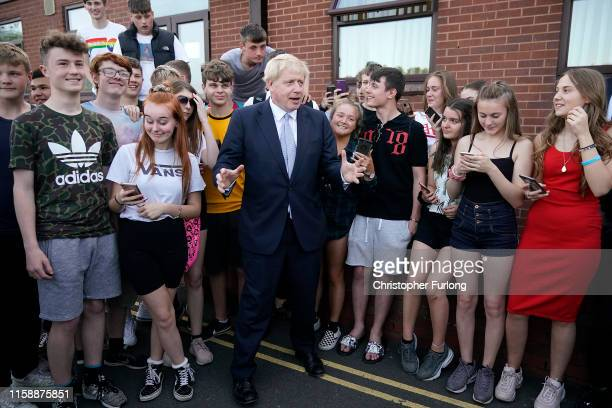 Boris Johnson leadership candidate for Britain's Conservative Party poses for a photgraph with local teenagers after a campaign event Wombourne Civic...