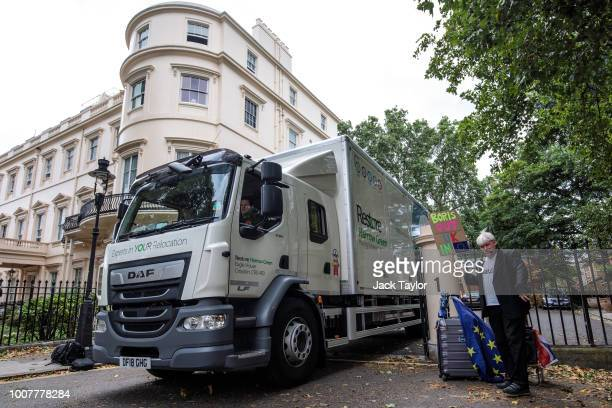 Boris Johnson look-a-like demonstrates outside as removal men drive out with the belongings from the former Foreign Secretary's grace-and-favour...