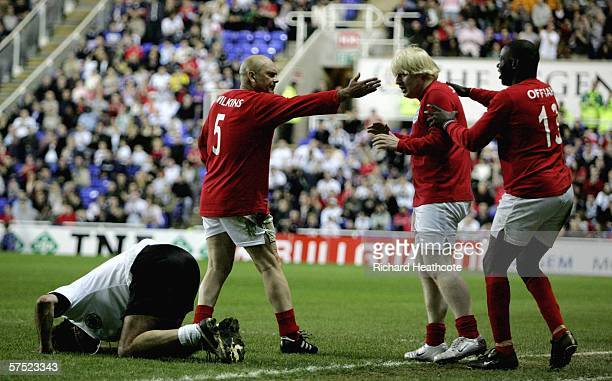 Boris Johnson looks apologetic after fouling Maurizio Gaudino of Germany during the Legends match between England and Germany at The Madejski Stadium...