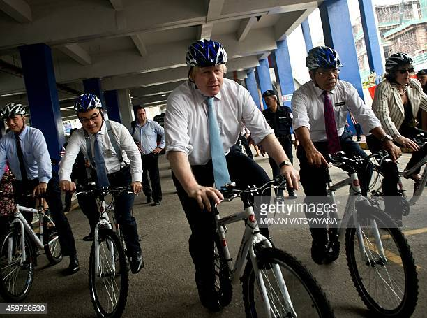 Boris Johnson Mayor of London rides a bicycyle on a citytour in Kuala Lumpur on December 1 2014 Johnson is in Malaysia as part of his sixday trade...