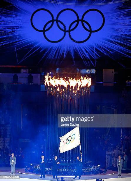 Boris Johnson mayor of London watches as Jacques Rogge President of the International Olympic Committee presnets the Olympic flag to Eduardo Paes...