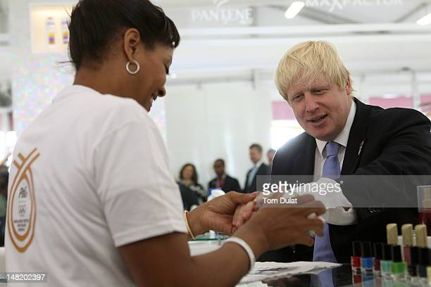 Boris Johnson meets nail artist during the opening of the P&G Salon at the Olympic Village on July 12, 2012 in London, England.