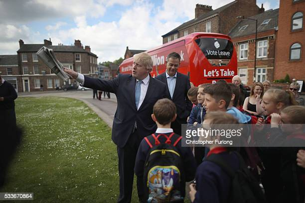 Boris Johnson MP chats to school children in the City of York during the Brexit Battle Bus tour of the UK on May 23 2016 in York England Boris...