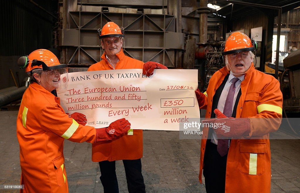 Boris Johnson MP, Gisela Stuart MP and Douglas Carswell throw a cheque into furnace during a tour of the JBMI Group, Kingsilver Refinery in Hixon, Staffordshire during the Vote Leave, Brexit Battle Bus tour on May 17, 20016 in Stafford, England. Boris Johnson and the Vote Leave campaign are touring the UK in their Brexit Battle Bus. The campaign is hoping to persuade voters to back leaving the European Union in the Referendum on the 23rd June 2016.